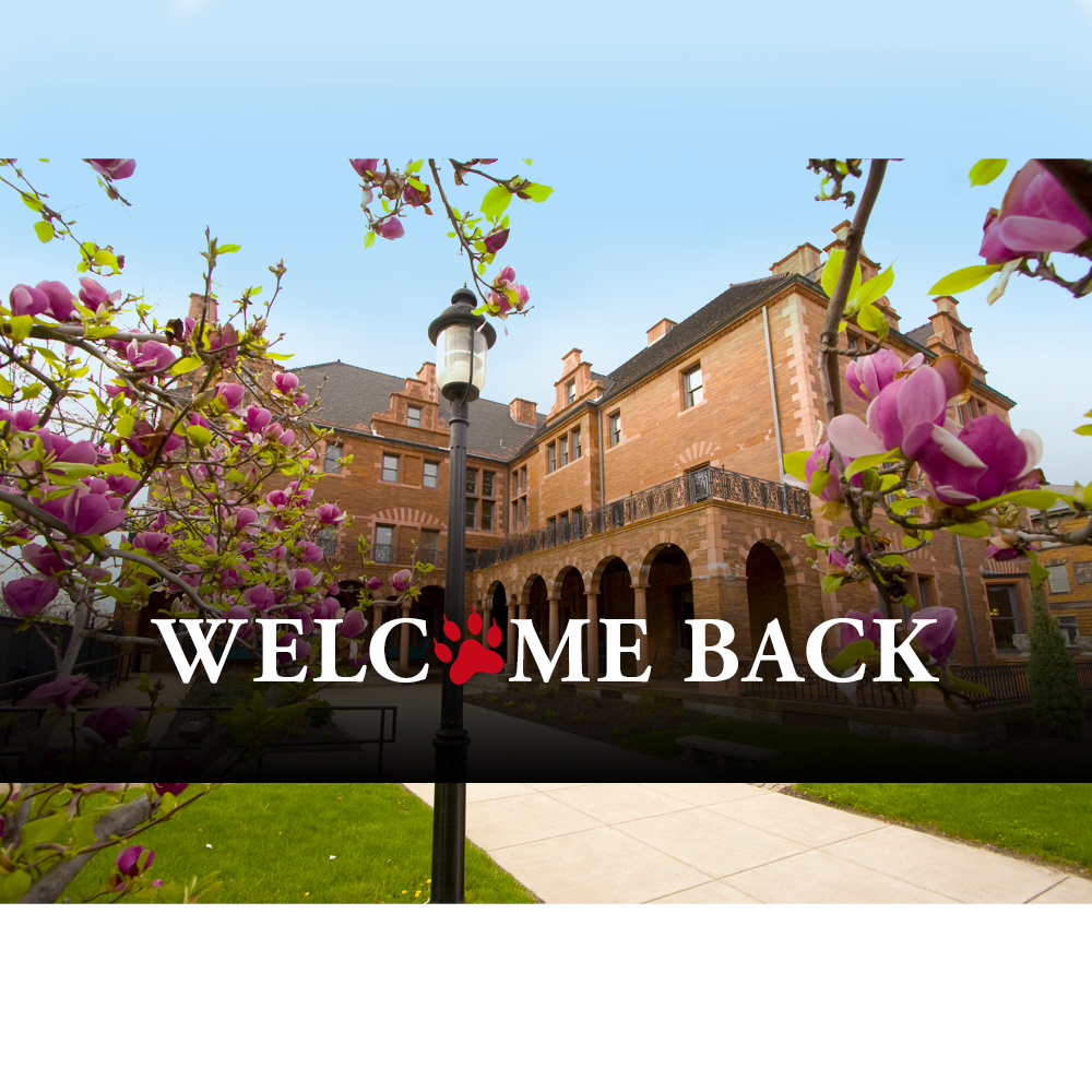 "Image of Byers Hall on CCAC's Allegheny Campus with pink flowers. Text reads: ""Welcome Back"" with red CCAC Wild Cat paw print."