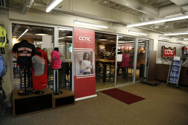 Campus bookstore front displating apparel and various merchandise.