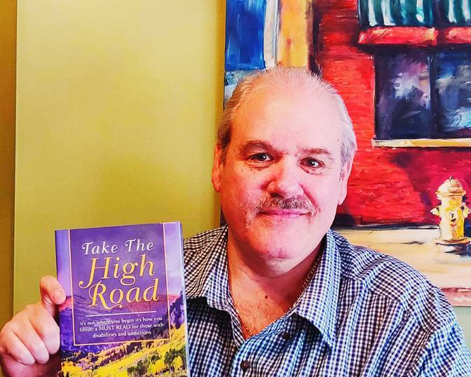 Jeffery Parker poses with his book,