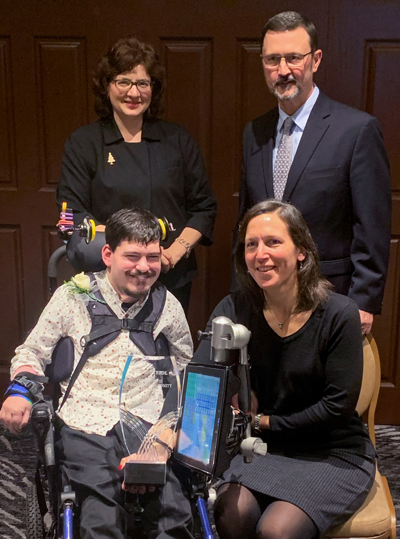 Photo (courtesy of ACHIEVA): Gathered around Mark Steidl to congratulate him on his award, are (clockwise from top left): Mary Richter, board chair of ACHIEVA; Steve Suroviec, president and CEO of ACHIEVA; and Michele Rosenthal, sister of the late Cecil and David Rosenthal.